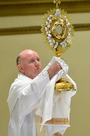 Bishop Malooly holds the monstrance during Eucharistic Adoration at St. Paul Church in Wilmington, Del., during the 2012 Cross Pilgrimage March 31, 2012. photo/ www.DonBlakePhotography.com