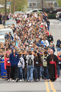 Bishop Malooly walks with members of Corpus Christi Parish as they carry the cross along Linden Street in Wilmington, Del., during the 2012 Cross Pilgrimage March 31, 2012. photo/ www.DonBlakePhotography.com