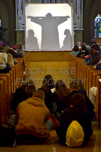 Participants watch the Stations of the Cross at S t. Hedwig Church in Wilmington, Del., during the 2012 Cross Pilgrimage March 31, 2012. photo/ www.DonBlakePhotography.com