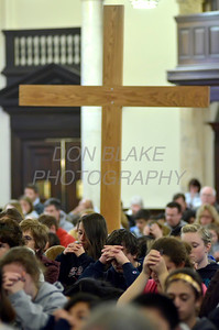 Participants pray during Eucharistic Adoration at St. Paul Church in Wilmington, Del., during the 2012 Cross Pilgrimage March 31, 2012. photo/ www.DonBlakePhotography.com
