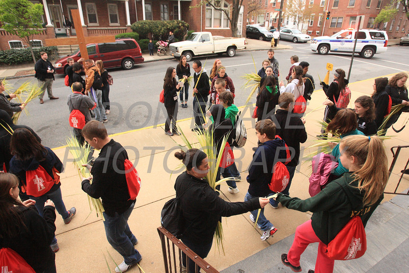 Participants receive palms as they leave S t. Hedwig Church in Wilmington, Del., during the 2012 Cross Pilgrimage March 31, 2012. photo/ www.DonBlakePhotography.com