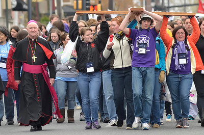 Bishop Malooly walks with members of Holy Cross Parish as they carry the cross along Lincoln Street in Wilmington, Del., during the 2012 Cross Pilgrimage March 31, 2012. photo/ www.DonBlakePhotography.com