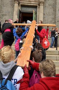 A cross is carried up the steps into St. Paul Church in Wilmington, Del., during the 2012 Cross Pilgrimage March 31, 2012. photo/ www.DonBlakePhotography.com