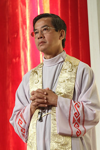 Bishop Joseph Nang Nguyen, Bishop of the Phat Diem Diocese in Viet Nam, joins his brother clergy on altar during the morning of adoration and Benediction.   (Page 27, June 21, 2012 issue)