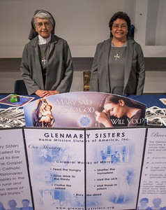 Glenmary Sisters Mary Ellen Barrette, left and Aida Badillo provided information on their mission order to Catholics attending the 2012 Eucharistic Congress. The Glenmary Sisters, founded in 1941, serve as missionaries to rural areas of the southern U.S. and Appalachia.  (Photo by Thomas Spink/Archdiocese of Atlanta)                                                                (Page 12, June 21, 2012 issue)