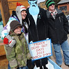 "Weston McDonald-Clatt, left, mother Kellie, and Bryson, get photographed next to ""grandpa'  during the 11th annual Frozen Dead Guy Days in Nederland.<br /> For a video and more photos, go to  <a href=""http://www.dailycamera.com"">http://www.dailycamera.com</a>.<br /> Cliff Grassmick / March 3, 2012"