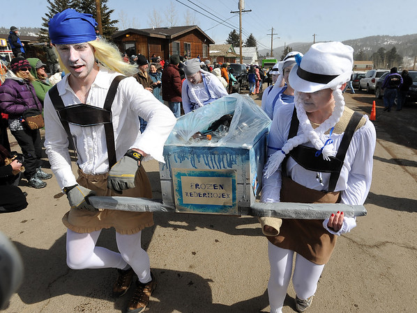 """Members of the Frozen Lederhosen coffin racing team join the Hearse Parade on Saturday.<br /> For a video and more photos, go to  <a href=""""http://www.dailycamera.com"""">http://www.dailycamera.com</a>.<br /> Cliff Grassmick / March 3, 2012"""