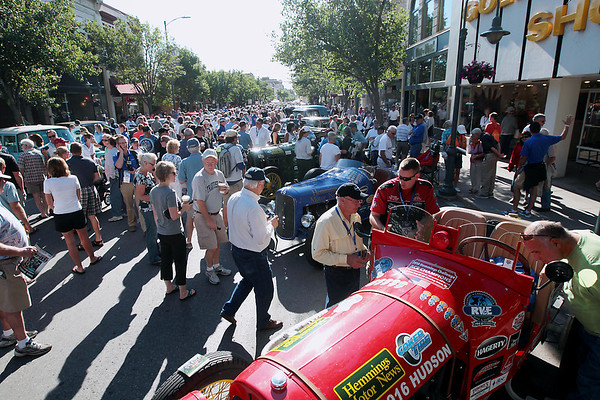 Record-Eagle/Keith King<br /> People and classic automobiles fill Front Street in downtown Traverse City Saturday, June 23, 2012 before the start of the 2012 Great Race which is approximately 2,283 miles over the span of nine days, taking racers around the Great Lakes, through Canada, and finishing in Dearborn, MI.