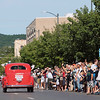Record-Eagle/Keith King<br /> Spectators wave as a 1938 Ford Coupe leaves the starting line on Front Street in Traverse City Saturday, June 23, 2012 during the 2012 Great Race which is approximately 2,283 miles over the span of nine days, taking racers around the Great Lakes, through Canada, and finishing in Dearborn, MI.