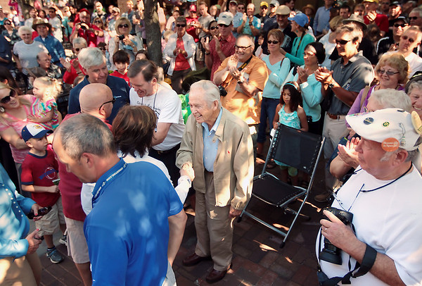 Record-Eagle/Keith King<br /> Attendees applaud after the introduction of former governor William Milliken, center, on Front Street in Traverse City Saturday, June 23, 2012 on Front Street prior to the start of the 2012 Great Race which is approximately 2,283 miles over the span of nine days, taking racers around the Great Lakes, through Canada, and finishing in Dearborn, MI.