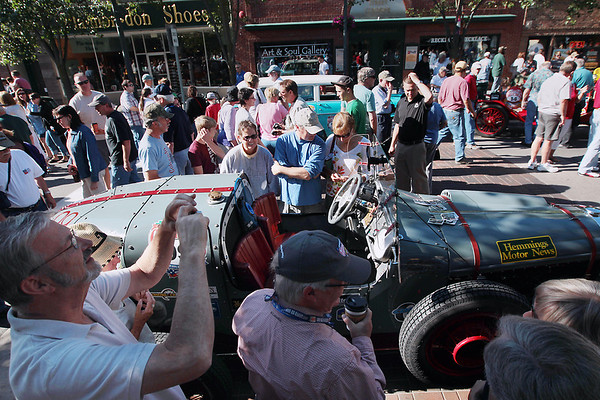 Record-Eagle/Keith King<br /> People gather on Front Street in Traverse City while some admire a 1931 Buick Racer owned by Pat Brothers of Bridal Veil, Ore. Saturday, June 23, 2012 before the start of the 2012 Great Race which is approximately 2,283 miles over the span of nine days, taking racers around the Great Lakes, through Canada, and finishing in Dearborn, MI.