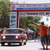 Record-Eagle/Keith King<br /> Waves take place as a 1957 Nash leaves the starting line on Front Street in Traverse City Saturday, June 23, 2012 during the 2012 Great Race which is approximately 2,283 miles over the span of nine days, taking racers around the Great Lakes, through Canada, and finishing in Dearborn, MI.
