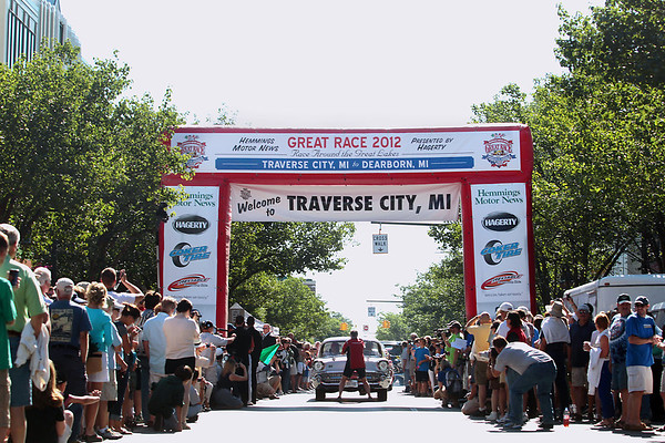 Record-Eagle/Keith King<br /> Vehicles take off on Front Street in downtown Traverse City Saturday, June 23, 2012 at the start of the 2012 Great Race which is approximately 2,283 miles over the span of nine days, taking racers around the Great Lakes, through Canada, and finishing in Dearborn, MI.
