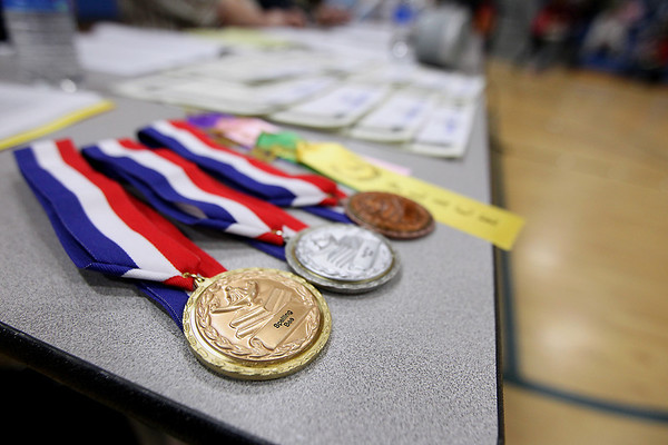 Record-Eagle/Keith King<br /> Awards lie on a table Wednesday, February 15, 2012 prior to the start of the 2012 Grand Traverse County Spelling Bee at Grand Traverse Academy. The top six and one alternate will advance to the Grand Traverse Regional Spelling Bee.
