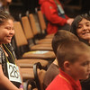 Globe/Roger Nomer<br /> Louenna Welbert, a fourth grader from Washington Carver Elementary in Neosho, left, and Belen Gonzales, a fourth grader at Columbian Elementary in Carthage, chat during the later rounds of the Spelling Bee.