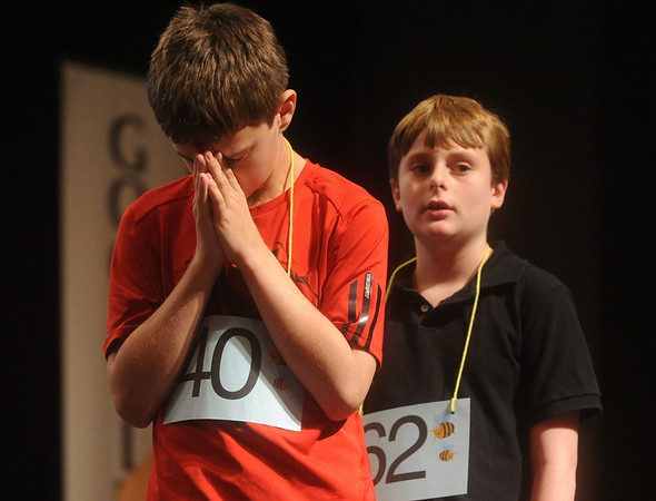 Globe/Roger Nomer<br /> Nash Kreitlein, a fifth grader at Lamar West Elementary, and David Green, a fourth grader at St. Mary's, anxiously wait for their words during Wednesday's Spelling Bee.  The duo came in second, Kreitlein, and third, Green.