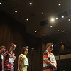 Globe/Roger Nomer<br /> Under the bright lights of Taylor Auditorium, spellers wait for their words during Wednesday's Spelling Bee.