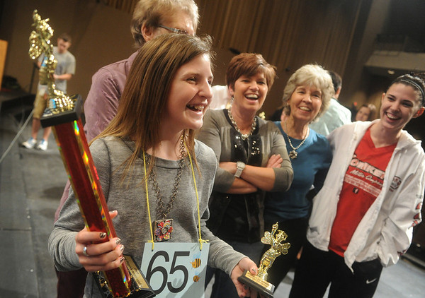 Globe/Roger Nomer<br /> Taylor Mailes, a fifth grader at Seneca Intermediate, celebrates with her family (from left) grandmother Janice Mailes, mother Sherri Mailes, grandmother Janice Vinyard and sister Tashina Mailes after winning the 2012 Spelling Bee.