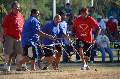 Ball in play during a stickball exhibition game on the Capitol lawn.