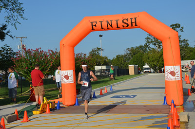 Overall 5k winner crosses the finish line.
