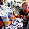 "Jack Ahrens, 7, grabs some oatmeal for home after eating it at the 16th Annual Lafayette Oatmeal Festival on Saturday.<br /> For more photos and a video of the festival, go to  <a href=""http://www.dailycamera.com"">http://www.dailycamera.com</a>.<br /> January 14, 2012 / Cliff Grassmick"