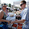"Connie Booth, left, buys peaches form  Thomas Pike of Tate Orchards on Palisade, CO.<br /> For more photos and a video from the Peach festival, go to  <a href=""http://www.dailycamera.com"">http://www.dailycamera.com</a>.<br /> Cliff Grassmick  / August 18, 2012"
