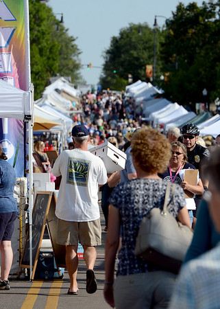 """Hundreds of people attended the Lafayette Peach Festival.<br /> For more photos and a video from the Peach festival, go to  <a href=""""http://www.dailycamera.com"""">http://www.dailycamera.com</a>.<br /> Cliff Grassmick  / August 18, 2012"""