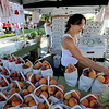 "Heather Morton-Burtness of Morton's Orchards in Palisade, CO, helps customers during the Lafayette Peach Festival on Saturday.<br /> For more photos and a video from the Peach festival, go to  <a href=""http://www.dailycamera.com"">http://www.dailycamera.com</a>.<br /> Cliff Grassmick  / August 18, 2012"