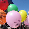 """Daryl Smith hands out balloons for the Lafayette Police Department.<br /> For more photos and a video from the Peach festival, go to  <a href=""""http://www.dailycamera.com"""">http://www.dailycamera.com</a>.<br /> Cliff Grassmick  / August 18, 2012"""