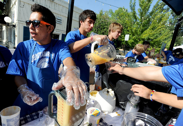 "Adrian Camacho, left, and Carlso Castanon, were among the Centaurus High School soccer players making peach smoothies  during the Lafayette Peach Festival on Saturday.<br /> For more photos and a video from the Peach festival, go to  <a href=""http://www.dailycamera.com"">http://www.dailycamera.com</a>.<br /> Cliff Grassmick  / August 18, 2012"