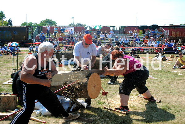 Rick and Penny Halvorson compete in the Jack and Jill sawing event on July 14 during the second annual Lumberjack Festival. • Katie Dahlstrom/Clinton Herald