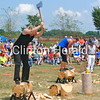 Kristy Cogar and Lindsay Daun compete in the underhand chop on July 14 at the second annual Lumberjack Festival. Competitors must chop half-way through the log, then turn around and chop through the other half. • Katie Dahlstrom/Clinton Herald