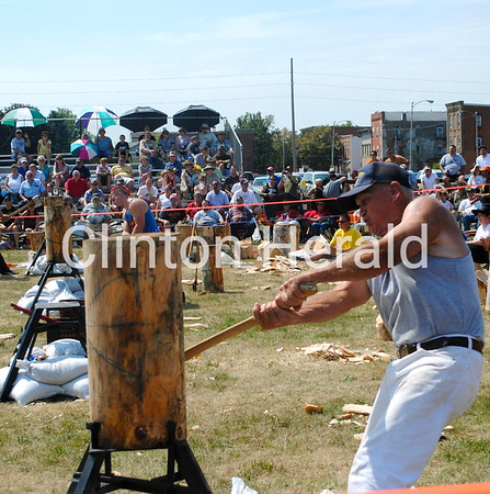 Gus Ott swings his ax in the standing block chop during the second annual Lumberjack Festival on July 14. • Katie Dahlstrom/Clinton Herald