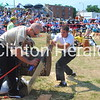 Frank Boyer saws through a 20 inch log on July 14 in the single-buck event during the second annual Lumberjack Festival. • Katie Dahlstrom/Clinton Herald