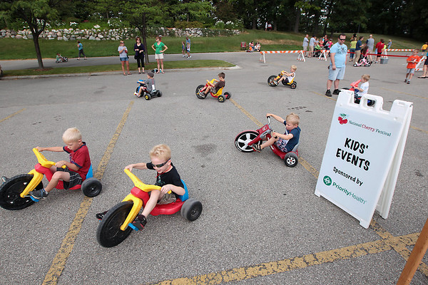 Record-Eagle/Keith King<br /> Participants take some laps Saturday, July 7, 2012 prior to the start of the National Cherry Festival Kids' Big Wheel Race at the Grand Traverse County Civic Center.