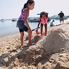 Record-Eagle/Keith King<br /> Emily Hart, left, 8, and Sonjena Hart, 5, try form a turtle out of sand Friday, July 13, 2012 during the National Cherry Festival Kids Sand Sculpture Contest at West End Beach in Traverse City.