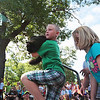 Record-Eagle/Keith King<br /> Keagen Hengesbach, 7, of Kingsley, carries his cat, Big D, near friend Emme Gleason, 7, of Kingsley, toward the judges Tuesday, July 10, 2012 during the National Cherry Festival Kids' Pet Show fat cat contest at F&M Park in Traverse City. Big D weighs approximately 15 pounds and two ounces.