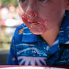 Record-Eagle/Jan-Michael Stump<br /> Aiden Fournier, 5, of Traverse City works on finishing his slice of pie in Monday's National Cherry Festival's Kid's Cherry Pie Eating Contest at F&M Park.