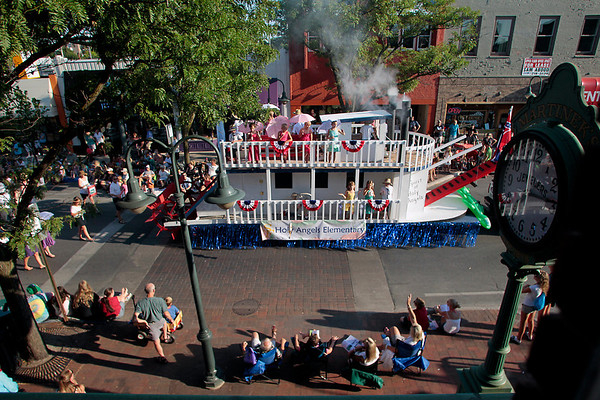 Record-Eagle/Jan-Michael Stump<br /> Holy Angels Elementary Mississippi-themed float rides in the National Cherry Festival Junior Royale Parade Thursday in downtown Traverse City.