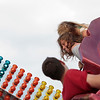 Record-Eagle/Jan-Michael Stump<br /> Quianah Cooper,14, left, and Tayler Johnson, 15, ride the Orbiter at the National Cherry Festival Midway on Monday evening.