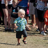 Record-Eagle/Keith King<br /> Bryce Young, 18 months, of Wood Haven, runs Friday, July 13, 2012 during the National Cherry Festival Toddler Trot at F&M Park in Traverse City.