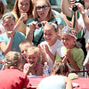 Record-Eagle/Jan-Michael Stump<br /> A crowd watches contestants in the National Cherry Festival's Kid's Cherry Pie Eating Contest Monday at F&M Park.