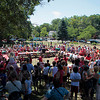 Record-Eagle/Jan-Michael Stump<br /> A crowd encircles the contestants in the National Cherry Festival's Kid's Cherry Pie Eating Contest Monday at F&M Park.