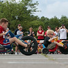 Record-Eagle/Keith King<br /> Participants pedal toward the finish line Saturday, July 7, 2012 during the National Cherry Festival Kids' Big Wheel Race at the Grand Traverse County Civic Center.