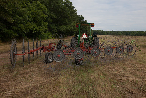 This machine rakes the hay into rows for the bailing machine. (Howard Pitkow/for Newsworks)