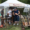 Cigar box instruments for sale in the vendor area. (Howard Pitkow/for Newsworks)