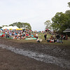 Following Saturday nights rain the concert area main pathways became very muddy. (Howard Pitkow/for Newsworks)