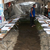 A silent auction that was comprised of donated photographs of musicians who have played the PFF. (Howard Pitkow/for Newsworks)