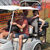 Folk Song Society Executive Director Levi Landis behind the wheel making his rounds in the campground. (Howard Pitkow/for Newsworks)