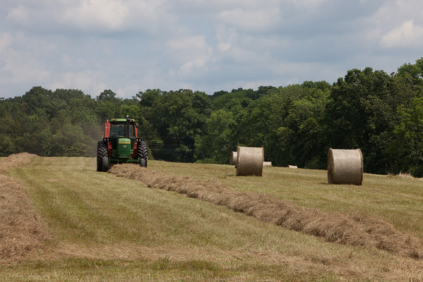 The farmer making round bails of hay in the parking area. (Howard Pitkow/for Newsworks)